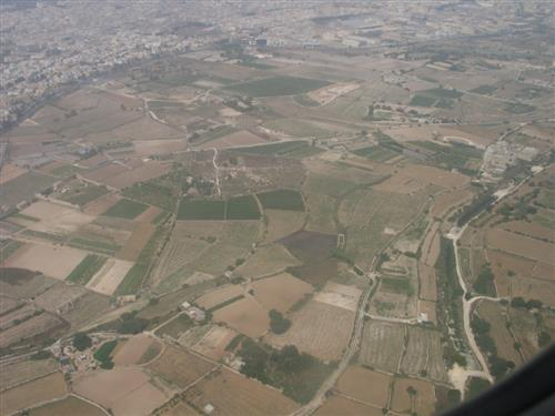 Typical Maltese Agricultural land parcels encroached by development Photo taken by Joseph Abela Medici